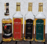 zleva: Gold Cock (bez udání stáří - whisky řezaná), Gold Cock Red Feathers - 3letá (blended), Gold Cock Black Feathers - 6letá (malt), Gold Cock Green Feathers - 12letá (malt)
