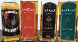 zleva: Gold Cock (bez udání stáří - whisky řezaná), Gold Cock Red Feathers - 3 letá (blended), Gold Cock Black Feathers - 6-ti letá (malt), Gold Cock Green Feathers - 12-ti letá (malt)